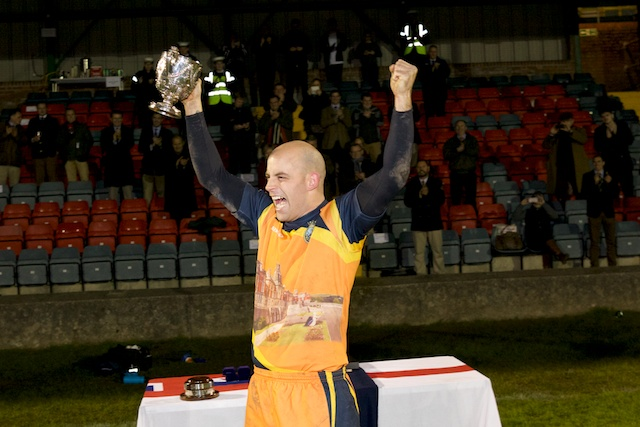 BRNC captain, Dane Smallbone, celebrates after receiving the Navy Cup